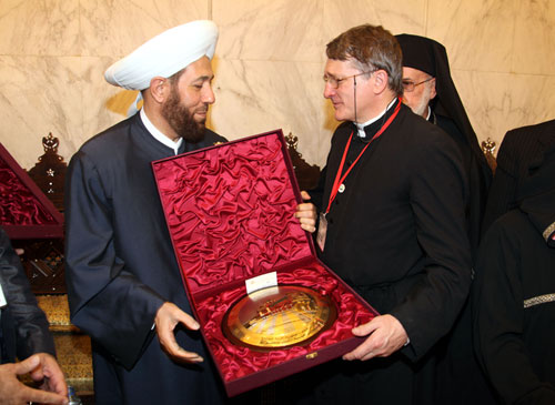 Receiving a gift from Dr Hassoun, the Grand Mufti of Syria