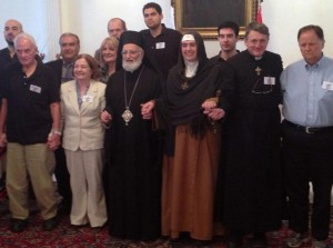 joining hands with Mother Agnes and the Melkite Patriarch in Damascus
