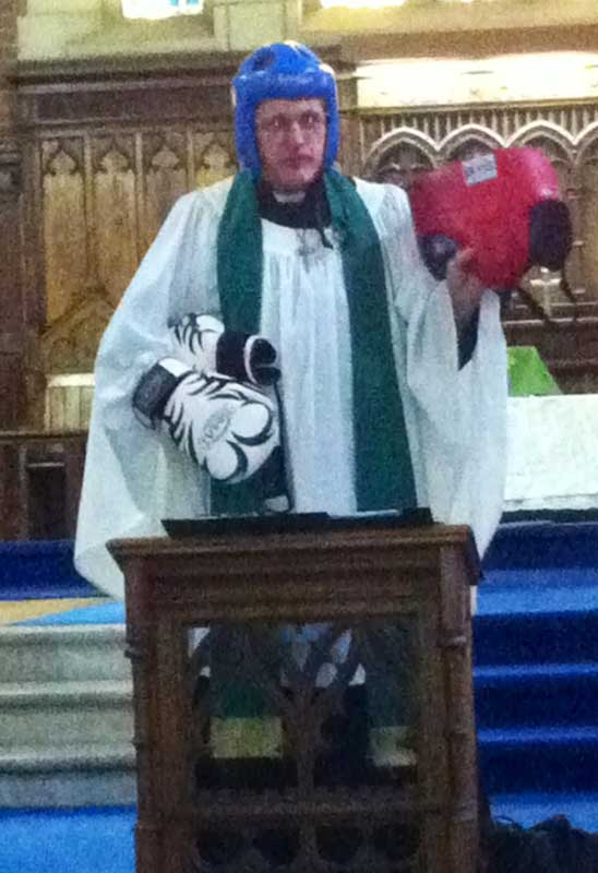 Father Dave preaching on the Armour of God